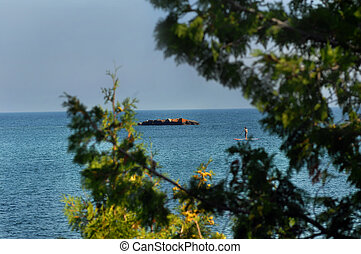 Boarding Lake Superior - Stand Up Paddle Boarder, or SUP,...