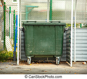 Garbage bin - Photo of single green garbage bin outside