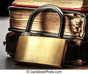 Key lock against the background of books