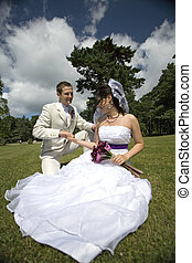 Bride and groom in the park - Bride and groom on grass...