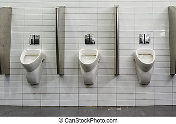 urinals in an new building for men only
