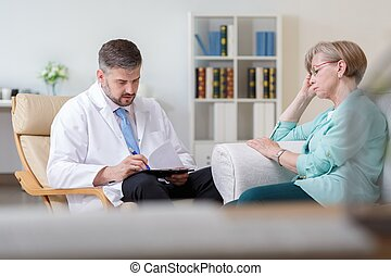 Doctor during home visit - Image of doctor with ill patient...