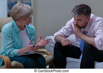 Psychoanalyst helping patient with phobia - Photo of female...