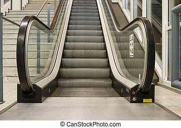 an escalator in the building - at the station have several...