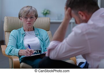 Personal counselor helping stressed man