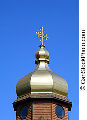 Dome and Finial - Golden colored dome and cross shaped...