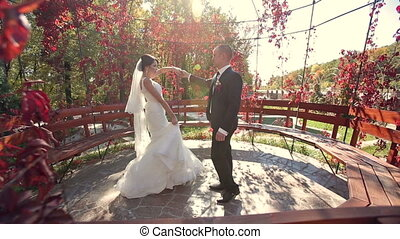Newlyweds Dancing At Open Air In Autumn