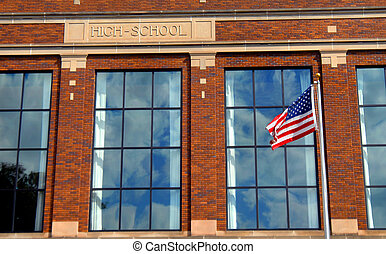 American School System - American flag flies in front of a...