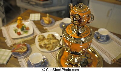 Table with sweets. Samovar with tea and pies - Puff is a...