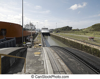 Miraflores Locks, Panama Canal - A Cargo ship and a Cruise...