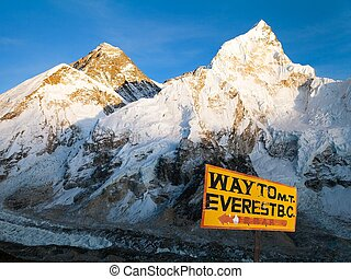 Evening view of Mount Everest from Kala Patthar and signpost...