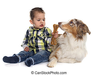 little boy and dog in front of white background
