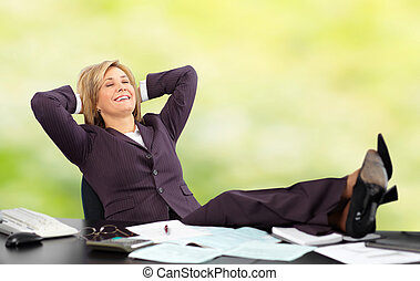 Relaxing mature business woman Green background - Beautiful...