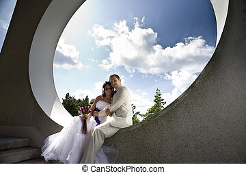 Groom and bride in modern architectural background