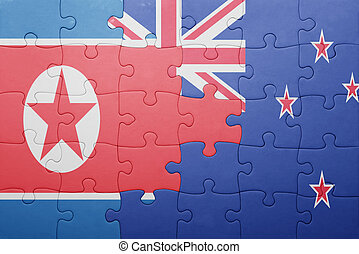 puzzle with the national flag of north korea and new zealand...