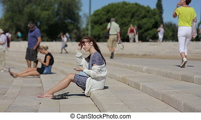 Portugal, Lisbon, september, 2015 - Teenage girl relaxing at the amphitheater of Belem in Portugal