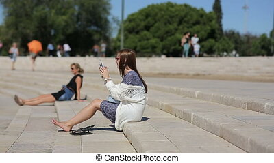 Portugal, Lisbon, september, 2015 - Teenage girl takeing photo at the amphitheater of Belem in Portugal