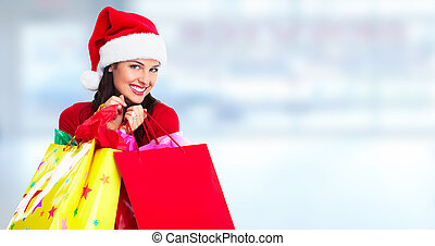 Shopping woman. - Happy Santa Christmas woman with bags over...