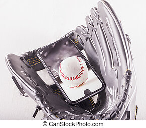 Baseball over smartphone in baseball glove, horizontal image