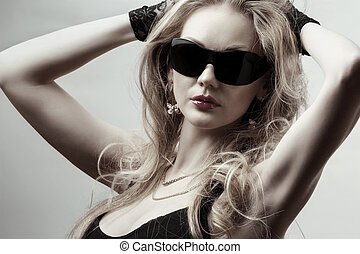 blonde wearing sunglasses - young gorgeous blonde wearing...
