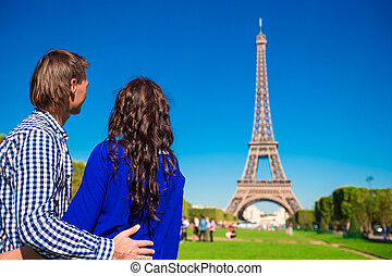 Family vacation on the Champ de Mars in Paris background the...