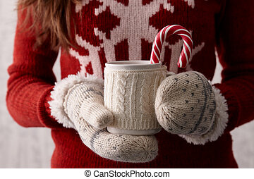 Winter coffee with a candy cane