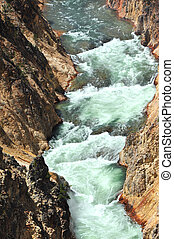 Canyon Walls in Yellowstone - As the Yellowstone River...