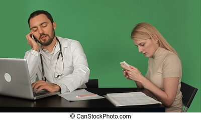 Serious doctor and patient on the phone in hospital on a Green Screen, Chroma Key