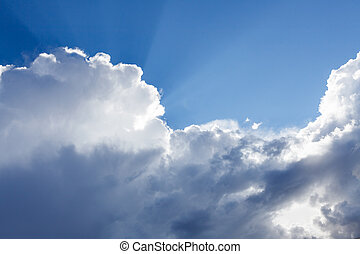 Sun rays shining behind cloud in the sky - Sun rays shining...