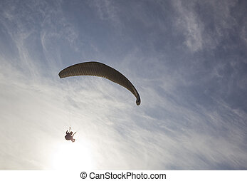 paragliding extreme sport - extreme active paraglider flyng...