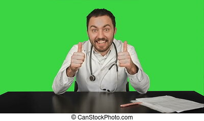 Smiling male doctor at medical office on a Green Screen, Chroma Key