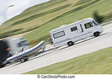travel mobile home - driving on a road with a mobile home...