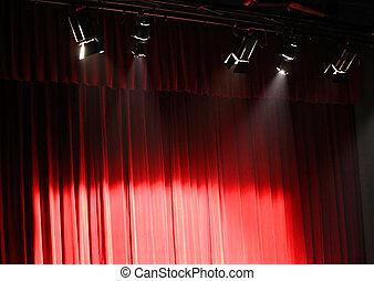 red theater curtain over the stage and the lights overhead projectors