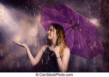 Beautiful storm woman catching falling rain drops - Purple...