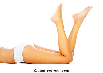 Beautiful female legs and body. Isolated over white.