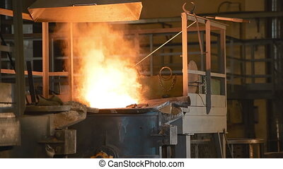 Melting of the metal at the factory. The liquid metal is...