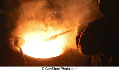 Melting of the metal at the industrial factory - Melting of...