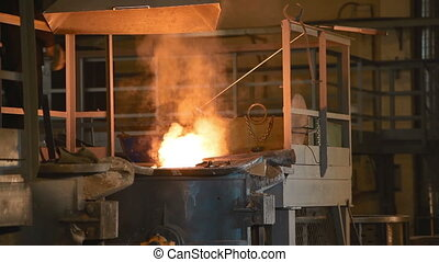 The liquid metal is poured in factory - Melting of the metal...