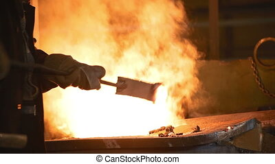 The liquid metal is poured into molds - Melting of the metal...