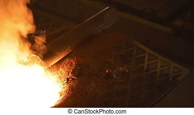 The metal is poured into molds - Melting of the metal at the...