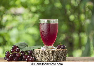 Grape juice in a glass on the table