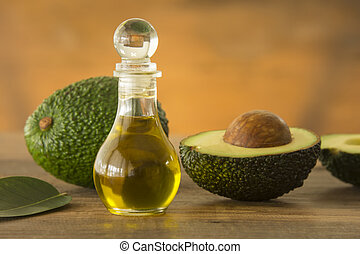 avocado - bottle of avocado essential oil with fresh avocado...