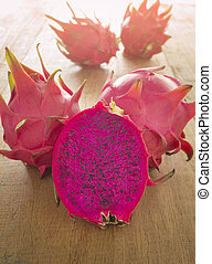 red dragon fruit - fresh sliced red dragon fruit on wood...