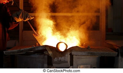 Worker controlling iron smelting in furnaces - Worker...