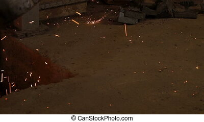Sparks. Metal smelting - Metal smelting process. Close up