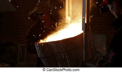 Molten metal is poured into mold - Molten metal is poured...