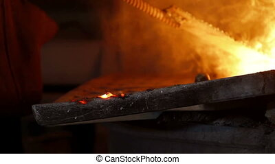 Worker controlling iron smelting in furnaces. Close up shot