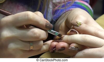 Girl doing beautiful nail design - Girl doing a nice...