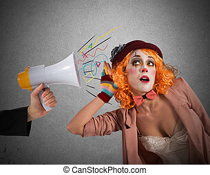 Alert clown - Clown hears a megaphone with alert expression