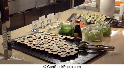 Making photo of sushi with mobile in cafe - Woman with smart...